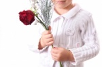 young_girl_holding_rose_in_her_hands_jpg17511